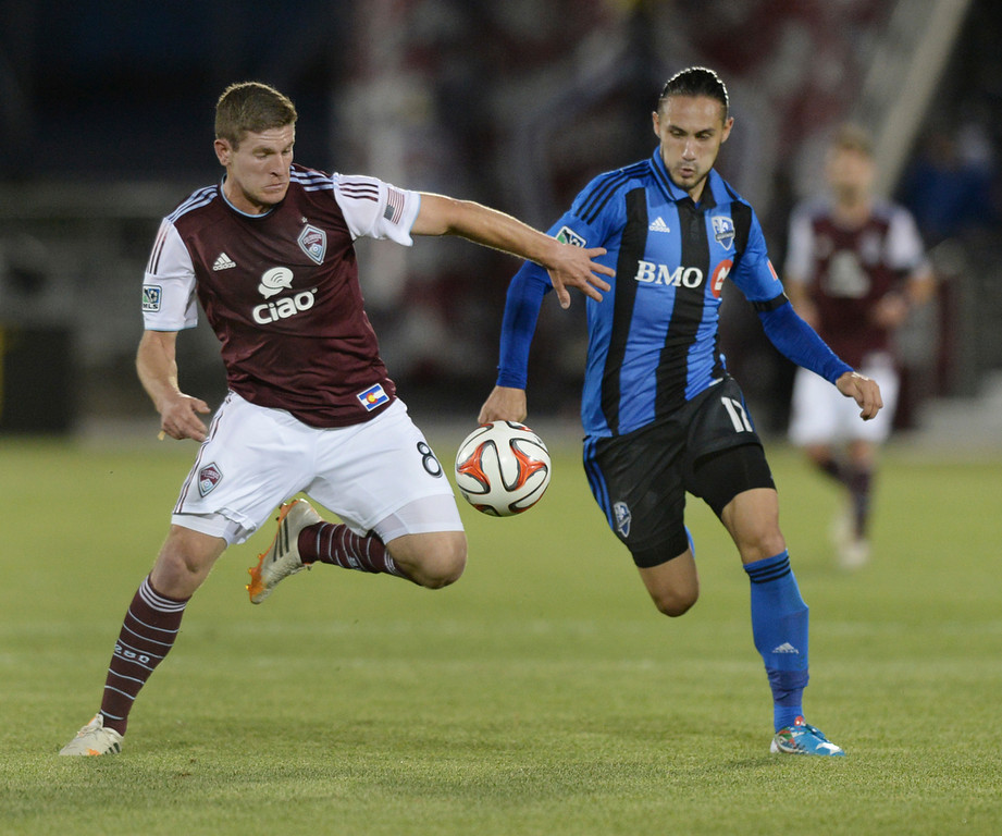 . Colorado midfielder Dillon Powers (8) fought off Montreal midfielder Issey Nakajima-Farran (17) in the second half. The Colorado Rapids defeated the Montreal Impact 4-1 Saturday night, May 24, 2014. (Photo by Karl Gehring/The Denver Post)