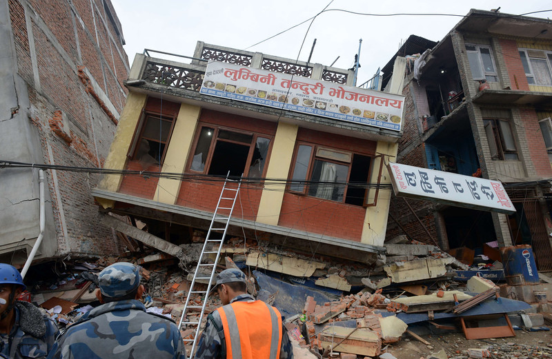 . Nepalese rescue personnel observe damaged buildings following an earthquake in Kathmandu on April 26, 2015. International aid groups and governments intensified efforts to get rescuers and supplies into earthquake-hit Nepal on April 26, 2015, but severed communications and landslides in the Himalayan nation posed formidable challenges to the relief effort. As the death toll surpassed 2,000, the US together with several European and Asian nations sent emergency crews to reinforce those scrambling to find survivors in the devastated capital Kathmandu and in rural areas cut off by blocked roads and patchy phone networks. PRAKASH MATHEMA/AFP/Getty Images