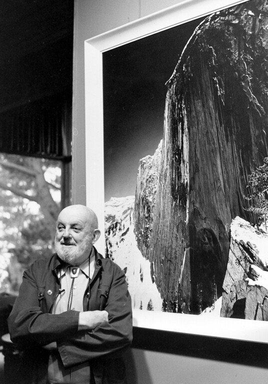 """. In this Dec. 2,1980 photo showing late photographer, Ansel Adams posing in front of his photograph of one the views of Yosemite National Park titled \""""Monolith:  The Face of Half Dome, 1927,\"""" in his home in Carmel Highlands, Calif.  (AP Photo/Paul Sakuma,File)"""