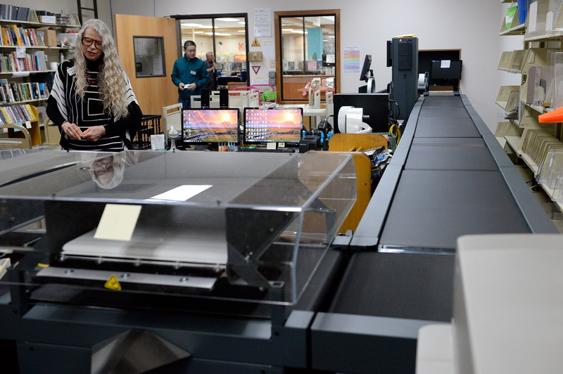 A conveyor belt sends books to their appropriate destinations inside of the Chico library Thurs. Feb. 2, 2017. (Bill Husa -- Enterprise-Record)