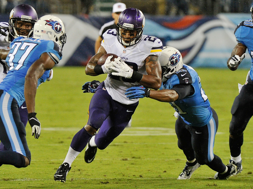 . Running back Joe Banyard of the Minnesota Vikings rushes against the Tennessee Titans. (Photo by Frederick Breedon/Getty Images)