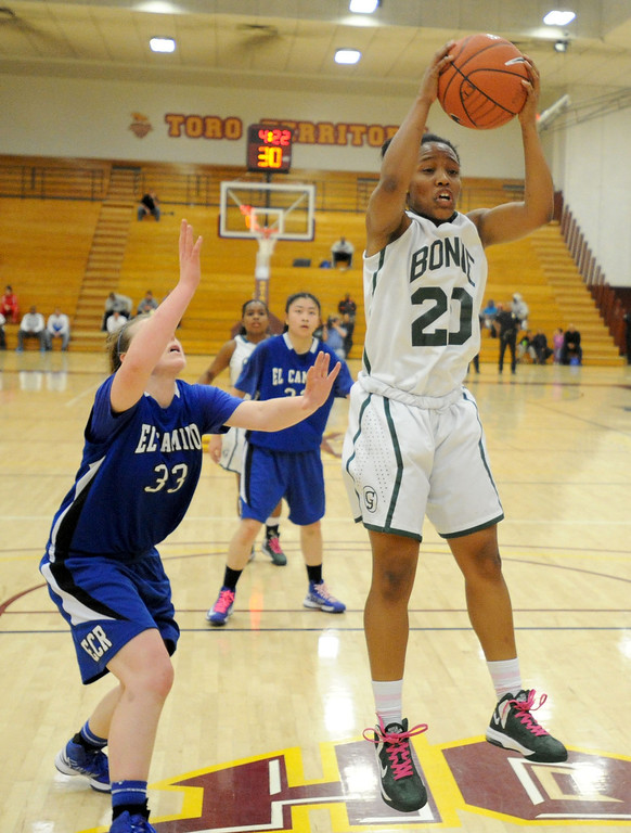 . 02-23-2012--(LANG Staff Photo by Sean Hiller)- Narbonne beat El Camino Real 47-39 in Saturday\'s L.A. City Section Division I semifinal girls basketball game. Narbonne\'s Jade Everage (20) grabs a rebound over El Camino\'s Shaina Van Stryk (33).
