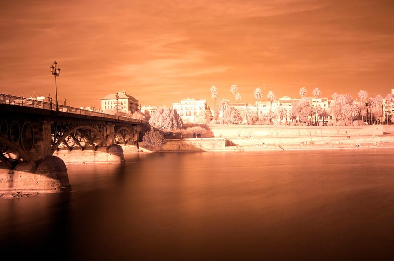 Infrared image of Triana Bridge and Guadalquivir river, Seville, Spain