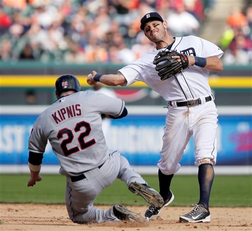 . Detroit Tigers second baseman Ian Kinsler throws to first afterr getting a force out on Cleveland Indians\' Jason Kipnis during the ninth inning of a baseball game Sunday, Sept. 14, 2014, in Detroit. Cleveland\'s Yan Gomes hit into the double play. The Tigers defeated the Indians 6-4. (AP Photo/Duane Burleson)