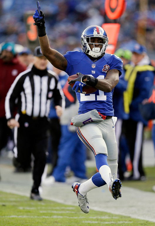 . New York Giants cornerback Dominique Rodgers-Cromartie (21) runs back an interception to the end zone in the second half of an NFL football game against the Tennessee Titans, Sunday, Dec. 7, 2014, in Nashville, Tenn. The apparent touchdown was nullified by a penalty. (AP Photo/James Kenney)