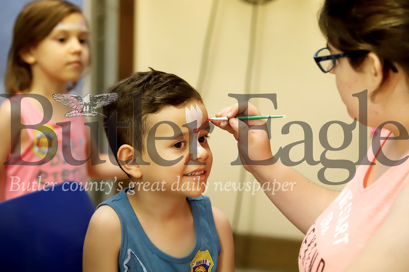 Matthew Vaniglin of Cranberry gets his face painted Thursday at the Harmony Fire Department open house, part of the town's Fourth of July celebration Thursday. Seb Foltz/Butler Eagle