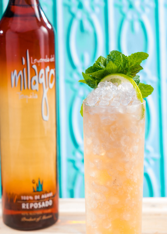 . For National Tequila Day (July 24), try this Mayan Mule, created by Milagro Brand Ambassador Jamie Salas. www.milagrotequila.com<br> -2 parts Milagro Resposado<br> -½ part Fresh Lime Juice<br> -2 dashes Angostura bitters<br> -3 parts Ginger Beer<br> -Mint sprigs<br> -Lime wheel<br> Place 2-3 ice cubes in a Collin glass. Add fresh squeezed lime juice, Milagro Resposado, ginger beer and bitters. Garnish with mint sprigs and a lime wheel.