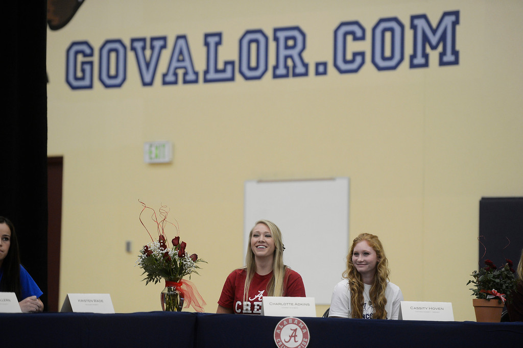 . HIGHLANDS RANCH, CO. - FEBRUARY 05: Valor Christian High School athletes, Charlotte Adkins, left, rowing, and Cassity Hoven, right, soccer, await their introduction during the National Letter of Intent Day assembly at Valor Christian  Wednesday morning, February 05, 2014. Adkins, a rowing athlete, chose the University of Alabama, Hoven, a soccer standout, signed with Concordia University-Nebraska.  (Photo By Andy Cross / The Denver Post)