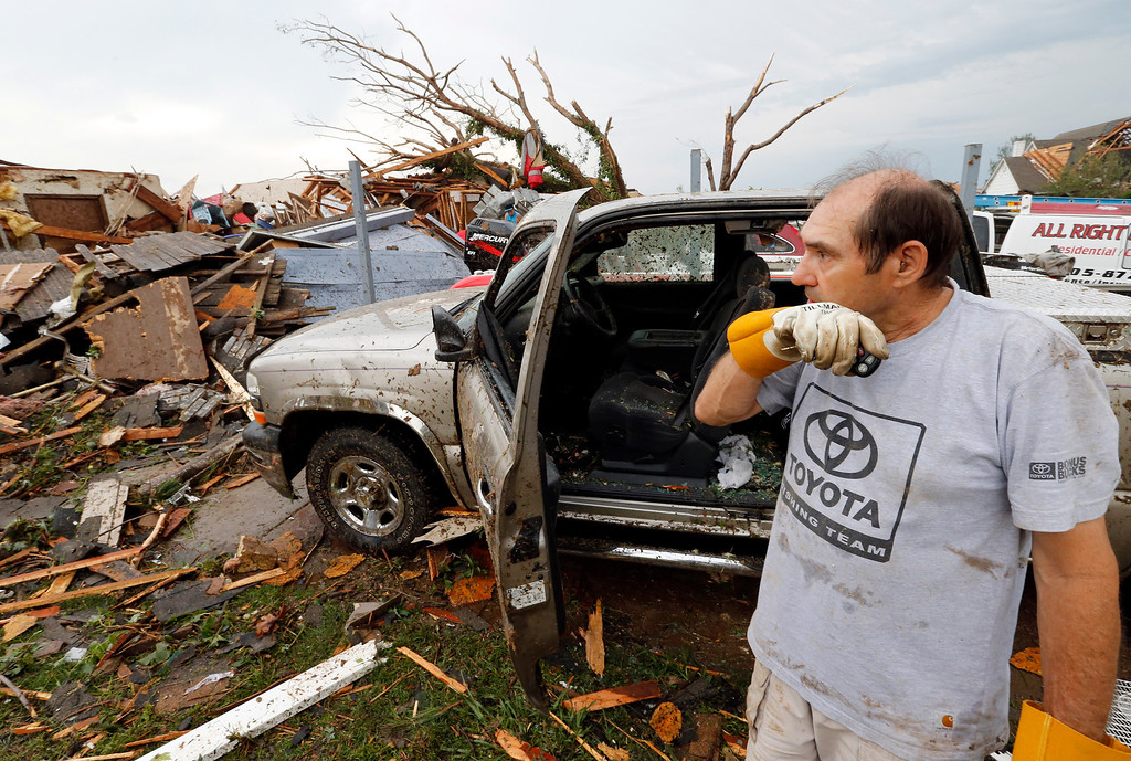 . Allen Anderson surveys the damage to his home, Monday, May 20, 2013  in Moore, Okla. A monstrous tornado roared through the Oklahoma City suburbs, flattening entire neighborhoods with winds up to 200 mph, setting buildings on fire and landing a direct blow on an elementary school. (AP Photo/The Oklahoman, Steve Sisney)