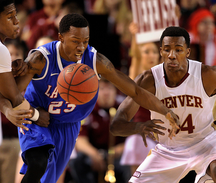 . Bulldogs guard Jaron Johnson (23) scrambled for a loose ball with Denver Pioneer\'s Chris Udofia (34) in the first half. The University of Denver men\'s basketball team hosted the Louisiana Tech Bulldogs at Magness Arena Saturday night, March 9, 2013. (Photo By Karl Gehring/The Denver Post)