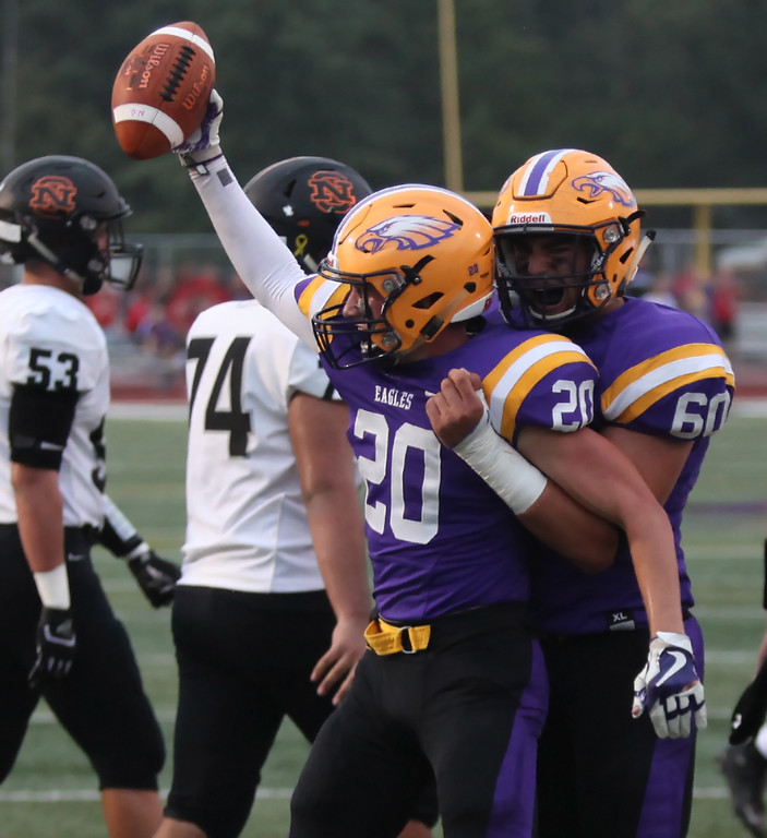 . Randy Meyers - The Morning Journal<br> Avon\'s Alec Fischer is congratulated by Zach Rimko after recovering a North Olmsted fumble near the goal line during the first quarter on Sept. 14.