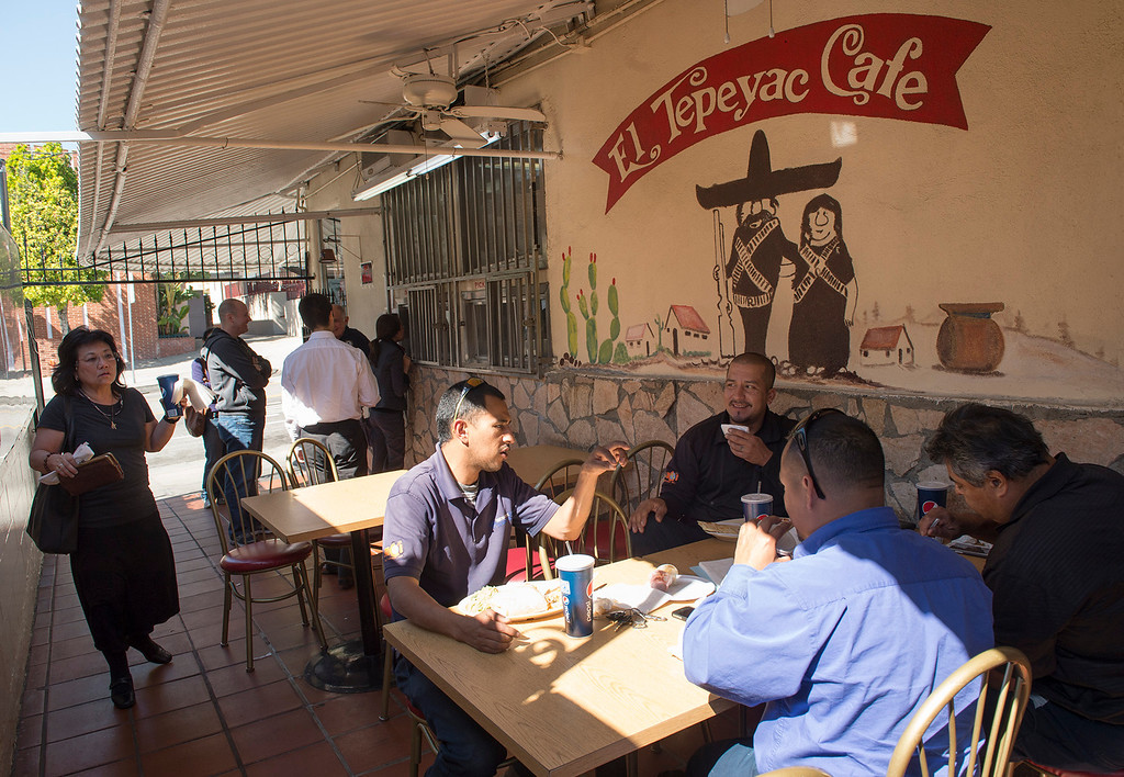 . Diners arrive for lunch at Manuel\'s Original El Tepeyac Cafe on Evergreen Avenue in Boyle Heights Feb. 25, 2013.  The rosary for owner Manuel Rojas, who died Feb. 11, will be tonight at Assumption Church, across the street from the restaurant.  (SGVN/Staff photo by Leo Jarzomb)