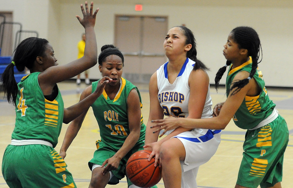 . Bishop Amat\'s Janae Chamois drives to the basket between the Long Beach Poly defense in the second half of a CIF State Southern California Regional semifinal basketball game at Bishop Amat High School on Tuesday, March 12, 2013 in La Puente, Calif. Long Beach Poly won 52-34.  (Keith Birmingham Pasadena Star-News)