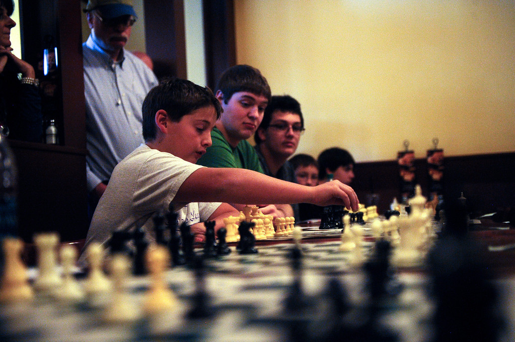 . DENVER CO: Nov. 2, 2013  Aidan Marco, 12, makes a move against grand chess master Timur Gareev on Nov. 2, 2013 in Denver. Gareev, who was blindfolded during play, took on a variety of talented players from around the state of Colorado.   (Photo By Erin Hull/The Denver Post)