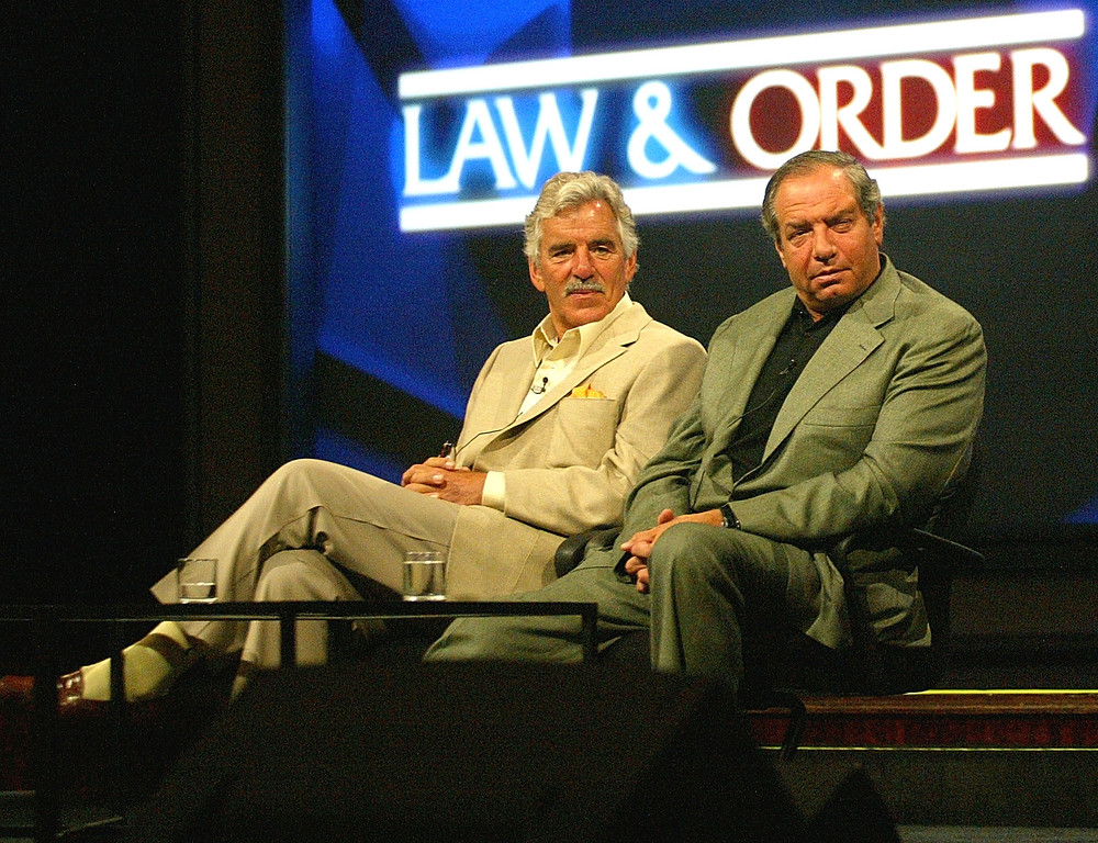 """. Actor Dennis Farina and Executive Producer/Creator Dick Wolf  of \""""Law & Order\"""" speak with the press during day two of the NBC Summer TCA Press Tour at the Century Plaza Hotel on June 11, 2004 in Los Angeles, California. (Photo by Frederick M. Brown/Getty Images)"""
