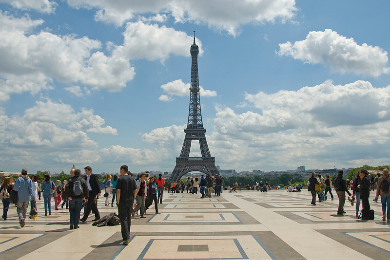 Tourists on ground outside the Eiffel Tower - Paris, France