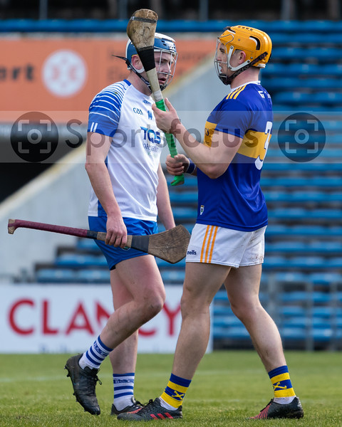 Tipperary's Ronan Maher stands his ground against Stephen Bennett of Waterford