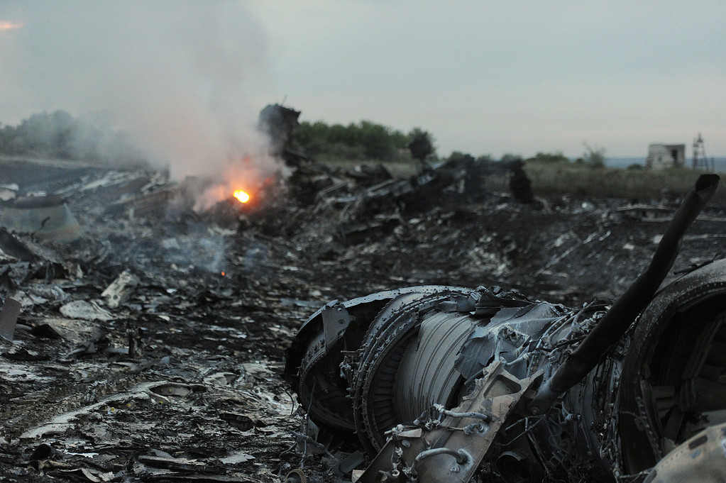 . A picture taken on July 17, 2014 shows wreckages of the malaysian airliner carrying 295 people from Amsterdam to Kuala Lumpur after it crashed, near the town of Shaktarsk, in rebel-held east Ukraine. Pro-Russian rebels fighting central Kiev authorities claimed on Thursday that the Malaysian airline that crashed in Ukraine had been shot down by a Ukrainian jet. AFP PHOTO/DOMINIQUE  FAGET/AFP/Getty Images