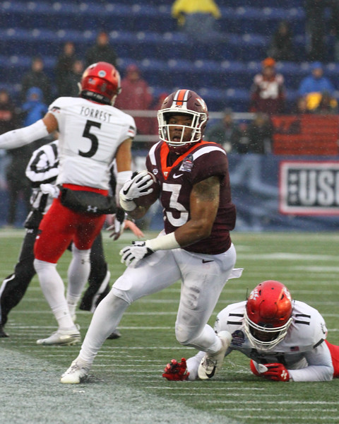 Virginia Tech runningback #13 Jalen Holsten steps out of bounds