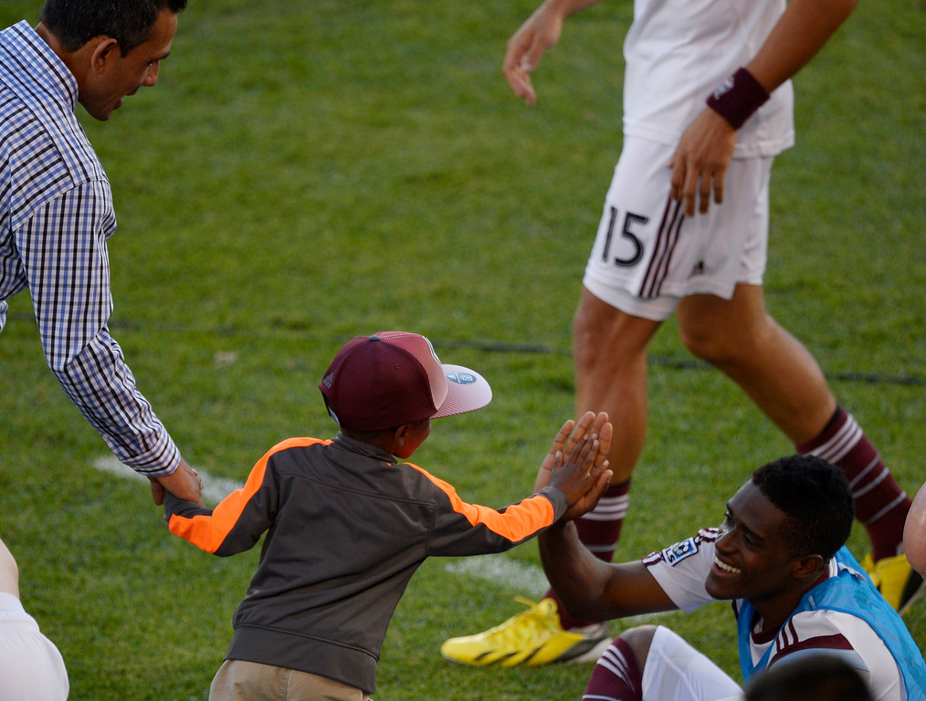 . COMMERCE CITY, CO - JUNE 01: Ronnie Hart 6 years old gets a high five from Colorado Rapids forward Deshorn Brown (26) after their game against the Houston Dynamo June 1, 2014 at Dick\'s Sporting Goods Park. Ronnie and his family are good friends with Colorado Rapids head coach Pablo Mastroeni. The Colorado Rapids defeated the Houston Dynamo 3-0. (Photo by John Leyba/The Denver Post)