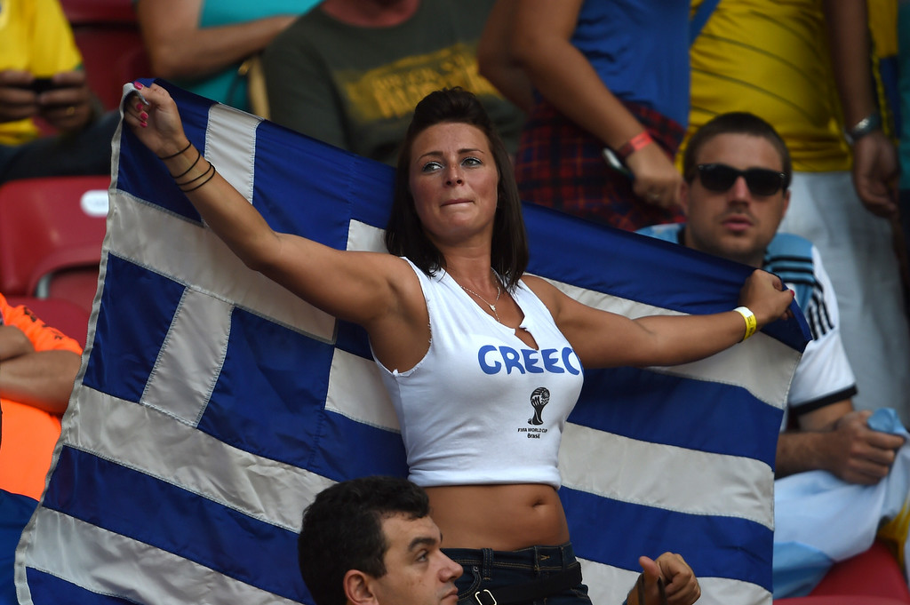 . A Greek fan cheers for her team before the start of the round of 16 football match between Costa Rica and Greece at Pernambuco Arena in Recife during the 2014 FIFA World Cup on June 29, 2014.  AFP PHOTO / PEDRO UGARTE