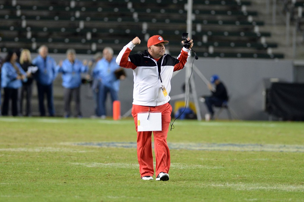 . Redlands East Valley High School head football coach Kurt Bruich raises his arms during the final seconds of the CIF-State Division II championship against Clayton Valley Charter on Saturday, December 20, 2014 at StubHub Center in Carson, Ca. REV won the game 34-33. (Photo by Micah Escamilla/Redlands Daily Facts)