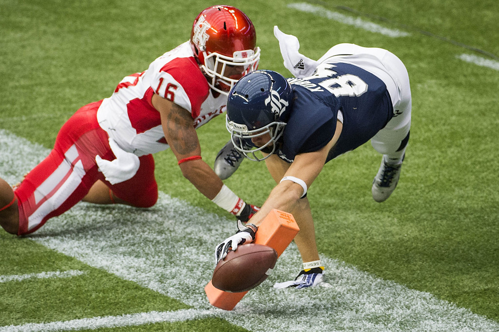 . Rice wide receiver Klein Kubiak (84) stretches for the goal line as Houston defensive back Adrian McDonald (16) defends during the first half of the annual Bayou Bucket NCAA college football game Saturday, Sept. 21, 2013, in Houston. (AP Photo/Houston Chronicle, Smiley N. Pool)