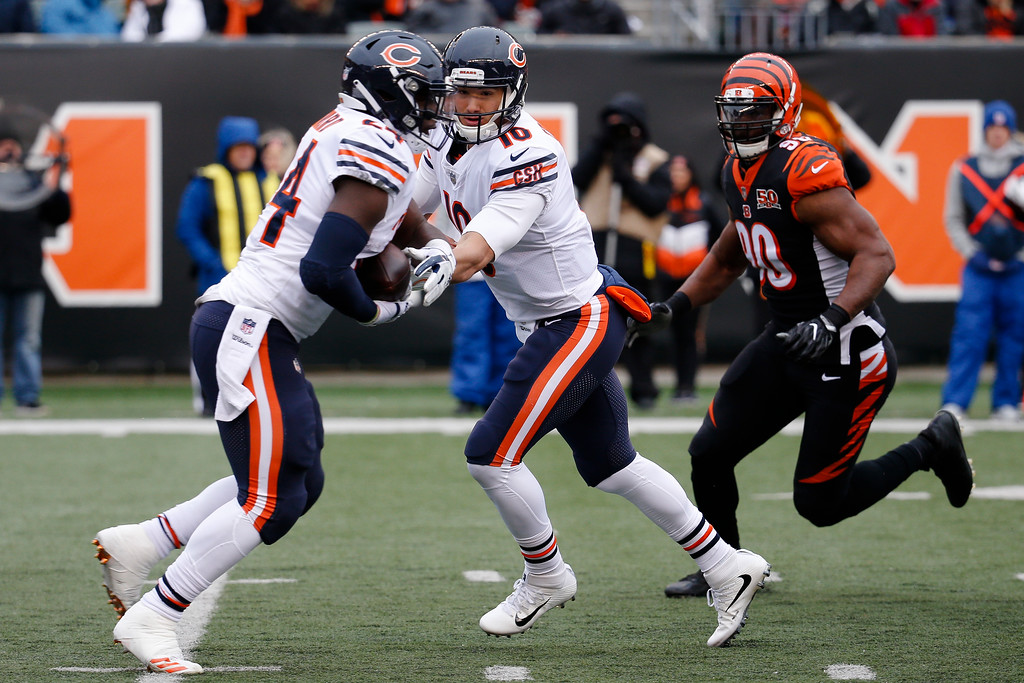. Chicago Bears quarterback Mitchell Trubisky (10) hands off the ball to running back Jordan Howard (24) in the first half of an NFL football game against the Cincinnati Bengals, Sunday, Dec. 10, 2017, in Cincinnati. (AP Photo/Frank Victores)