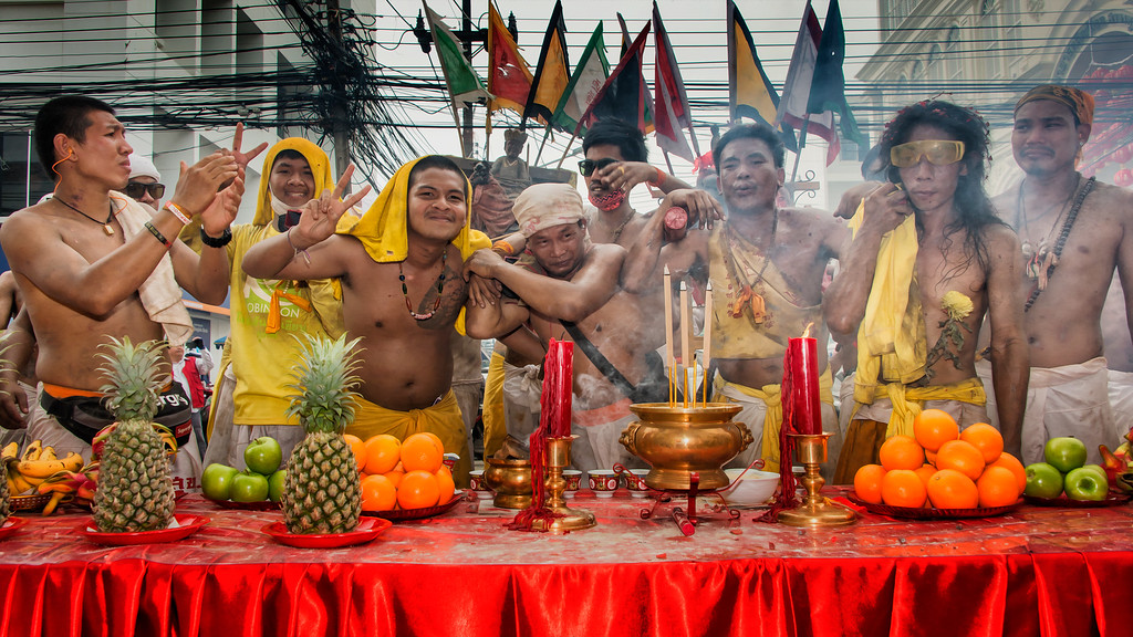 Shrine Carriers Giving Blessing at Hotel Offering Table, Phuket Vegetarian Festival, Thailand - 2015