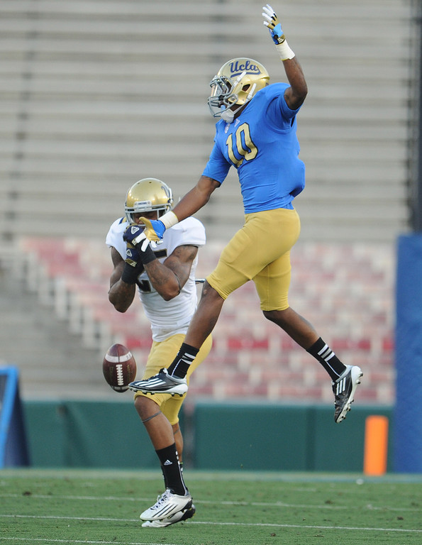 . UCLA linebacker Brandon Sermons (25) breaks-up a pass to UCLA\'s Kenneth Walker (10) during the football spring showcase college football game in the Rose Bowl on Saturday, April 27, 2013 in Pasadena, Calif.    (Keith Birmingham Pasadena Star-News)