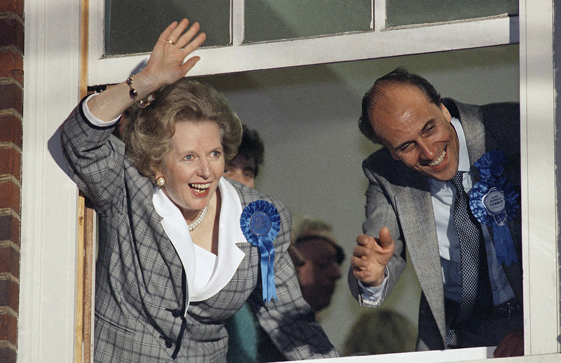 """. In this June 12, 1987 file photo, British Prime Minister Margaret Thatcher waves to supporters from Conservative Party headquarters in London after claiming victory in Britain\'s general election. Ex-spokesman Tim Bell says that Thatcher has died. She was 87. Bell said the woman known to friends and foes as \""""the Iron Lady\"""" passed away Monday morning, April 8, 2013. (AP Photo/File)"""