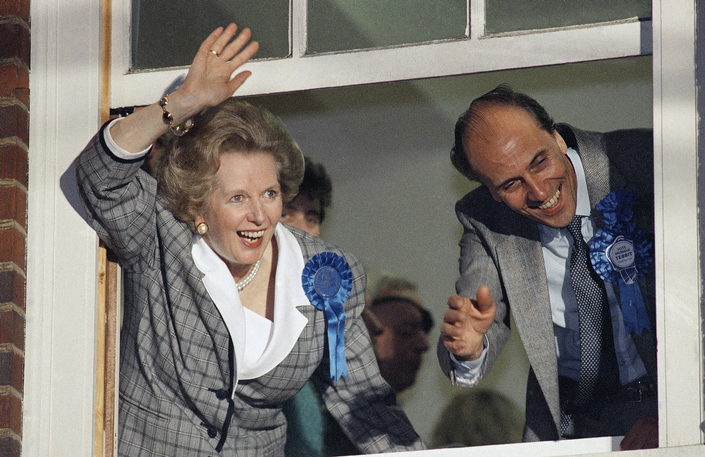 ". In this June 12, 1987 file photo, British Prime Minister Margaret Thatcher waves to supporters from Conservative Party headquarters in London after claiming victory in Britain\'s general election. Ex-spokesman Tim Bell says that Thatcher has died. She was 87. Bell said the woman known to friends and foes as ""the Iron Lady\"" passed away Monday morning, April 8, 2013. (AP Photo/File)"