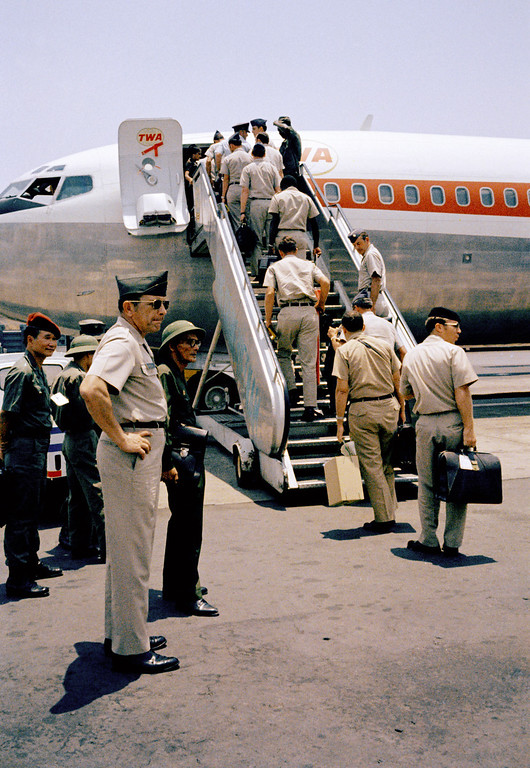 . In this March 29, 1973 photo, In a curious ending to a bizarre conflict, American troops board jets under the watchful eyes of North Vietnamese and Viet Cong observers in Saigon. As the last U.S. combat troops left Vietnam 40 years ago, angry protesters still awaited them at home. North Vietnamese soldiers took heart from their foes\' departure, and South Vietnamese who had helped the Americans feared for the future. While the fall of Saigon two years later � with its indelible images of frantic helicopter evacuations � is remembered as the final day of the Vietnam War, Friday marks an anniversary that holds greater meaning for many who fought, protested or otherwise lived it. (AP Photo)