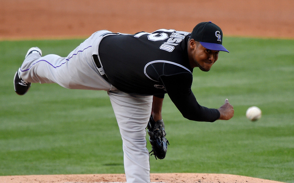 . Colorado Rockies starting pitcher Juan Nicasio throws to the plate during the second inning of a baseball game against the Los Angeles Dodgers, Saturday, April 26, 2014, in Los Angeles. (AP Photo/Mark J. Terrill)