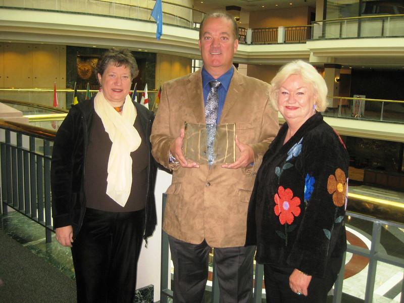 2011 11-19  L-R: Michelle Uchiyama (founding board member), Mark Galey (President), and Jackie Goodman (secretary-treasurer) with the award.