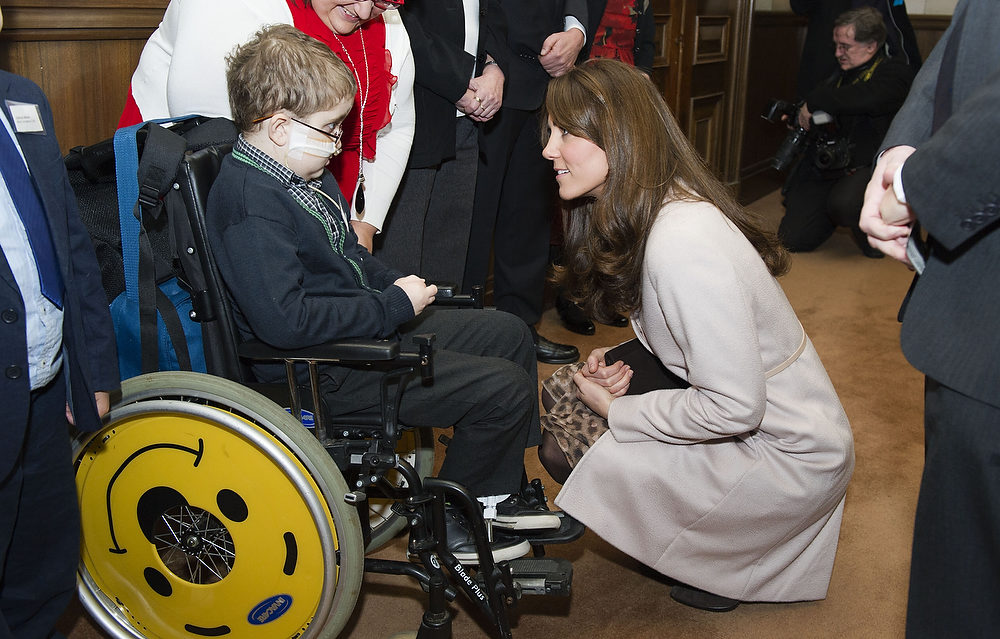 . Catherine, Duchess of Cambridge meets Oliver Duell during an official visit to the Guildhall on November 28, 2012 in Cambridge, England. (Photo by Samir Hussein/WireImage)