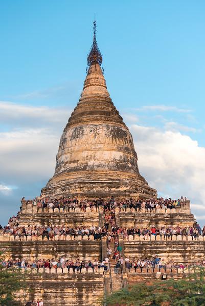 Visitors view susnset from terraces of Shwesandaw Pagoda, Bagan, Burma - Myanmar