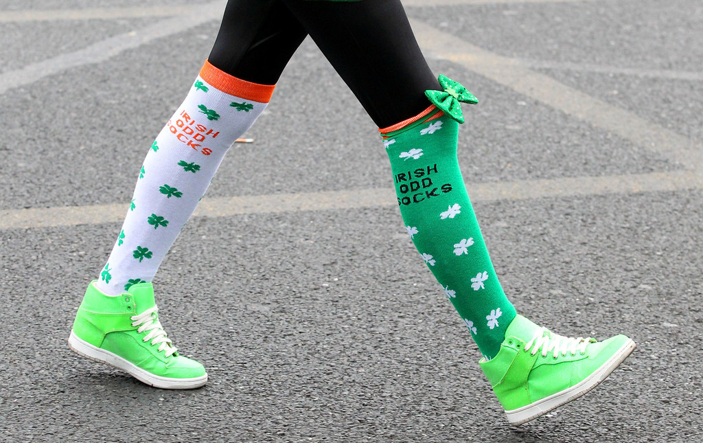 . A spectator wearing festive socks attends St Patrick\'s Day parade in Dublin on March 17, 2014. More than 100 parades are being held across Ireland to mark St Patrick\'s Day, the feast day of the patron saint of Ireland, with up to 650,000 spectators expected to attend the parade in Dublin. AFP PHOTO/ PETER MUHLY/AFP/Getty Images