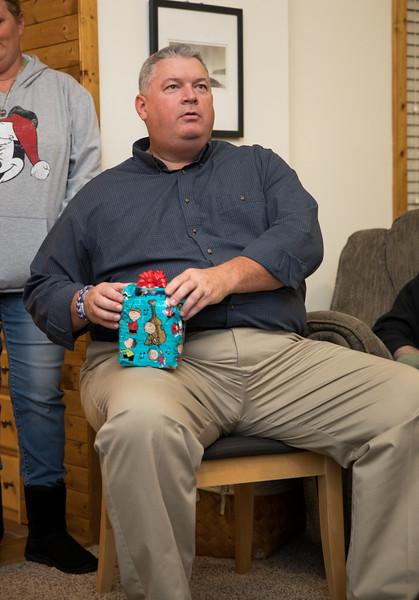Garrett opening secret santa gift.jpg