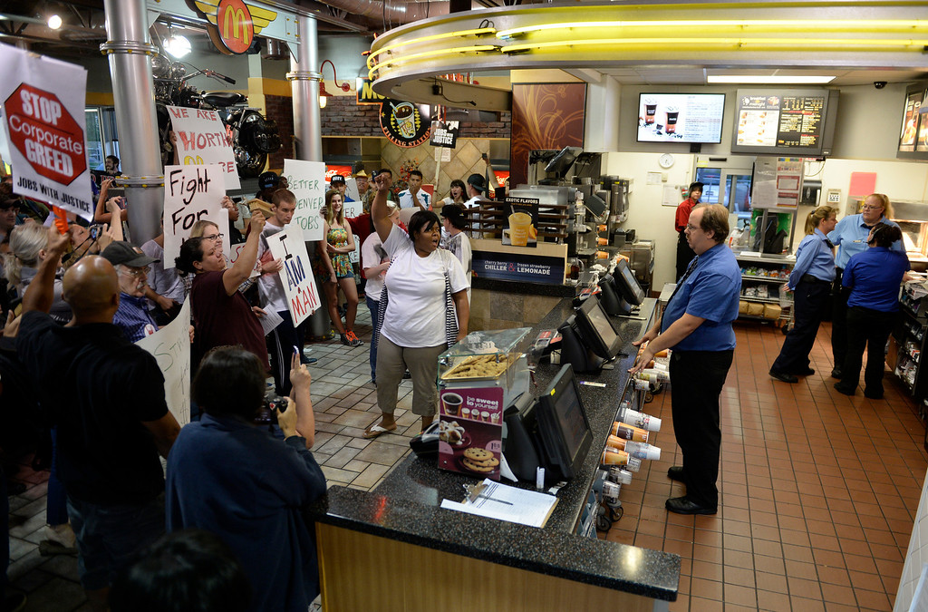 . NORTHGLENN, CO-August, 2013: Protesters, asking for better wages for fast food workers, take over a McDonald\'s in Northglenn, August 29, 2013. They are asking for $15 an hour for workers in this nationally organized event. (Photo By RJ Sangosti/The Denver Post)