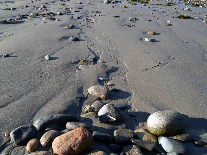 SEAL HARBOR BEACH Anyway, since I was there I thought I'd mosey on across the road and take a few shots of Seal Harbor while I was at it. (By the way, Martha Stewart lives around these parts, for those who might be interested.) I've always been intrigued by the beach, especially at ebbing tide when things are revealed. As always, I find myself fascinated with the rivulet patterns caused by the outgoing water left in the sand. The addition of the rocks is an added bonus.