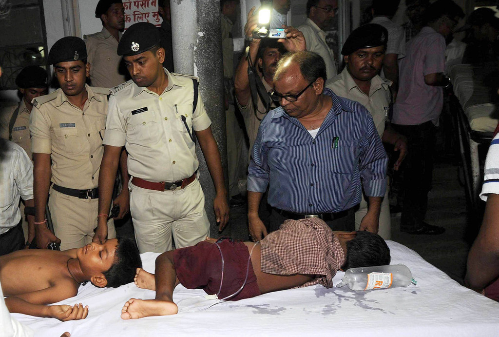 . Indian schoolchildren who consumed a free mid day meal at a school in the Saran district of Bihar state, receive medical treatment at a hospital in Patna on July 17, 2013.  Twenty-two children have died after eating a free lunch feared to contain poisonous chemicals at an Indian primary school, officials said, as the tragedy sparked angry street protests.  AFP PHOTOSTR/AFP/Getty Images