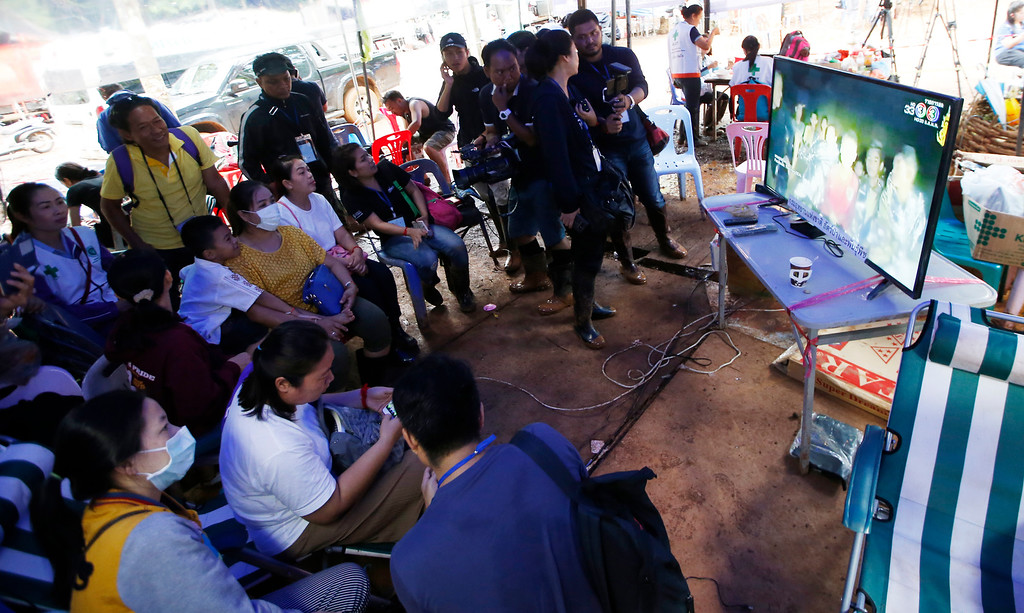 . Family members of the 12 boys and their soccer coach watch a video clip of 12 boys on television after they were found alive, in Mae Sai, Chiang Rai province, in northern Thailand, Wednesday, July 4, 2018. Rescuers found all 12 boys and their soccer coach alive deep inside a partially flooded cave in northern Thailand.(AP Photo/Sakchai Lalit)