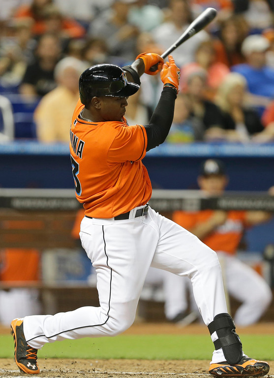 . Miami Marlins\' Marcell Ozuna hits a double in the fifth inning of an opening day baseball game against the Colorado Rockies, Monday, March 31, 2014, in Miami. (AP Photo/Lynne Sladky)
