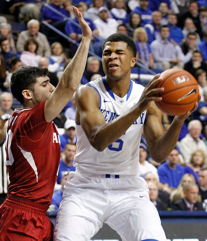 . Kentucky\'s Andrew Harrison (5) is pressured by Arkansas\' Kikko Haydar during the first half of an NCAA college basketball game Thursday, Feb. 27, 2014, in Lexington, Ky. (AP Photo/James Crisp)