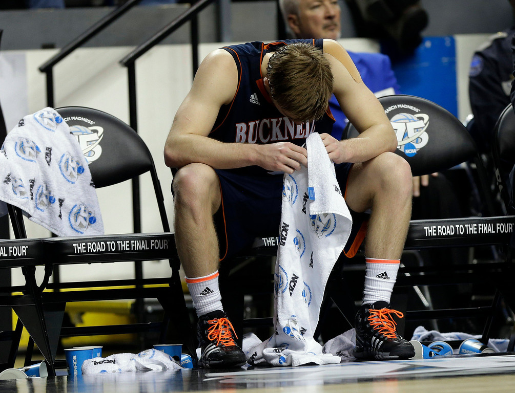 . Bucknell guard Steven Kaspar (3) sits on the bench in the final seconds of their 68-56 loss to Butler in the second round NCAA college basketball tournament game Thursday, March 21, 2013, in Lexington, Ky. Butler won  68-56. (AP Photo/John Bazemore