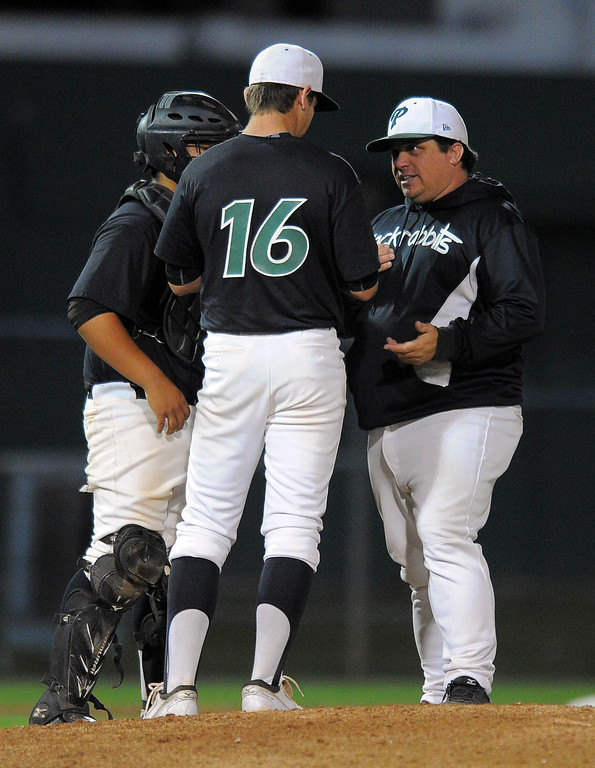 . LONG BEACH - 04/24/13 - (Photo: Scott Varley, Los Angeles Newspaper Group)  Long Beach Poly vs Lakewood in a Moore League baseball game at Blair Field. After giving up a run in the 6th inning, Poly pitcher Chris Castellanos has a chat on the mound with coach Toby Hess and catcher Robert Castaneda.