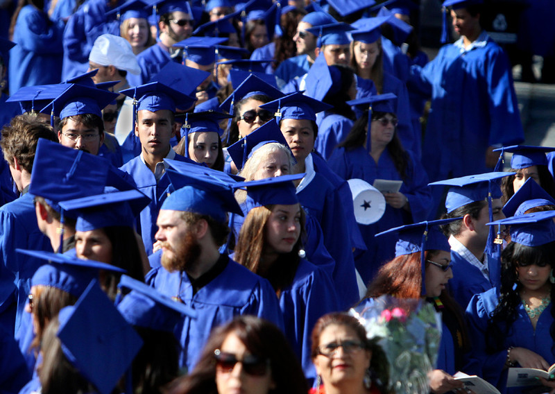 . A sea of blue gowns approaches the Cabrillo College football field in Aptos on Friday evening as hundreds of students prepare to graduate from the community college. (Kevin Johnson/Sentinel)