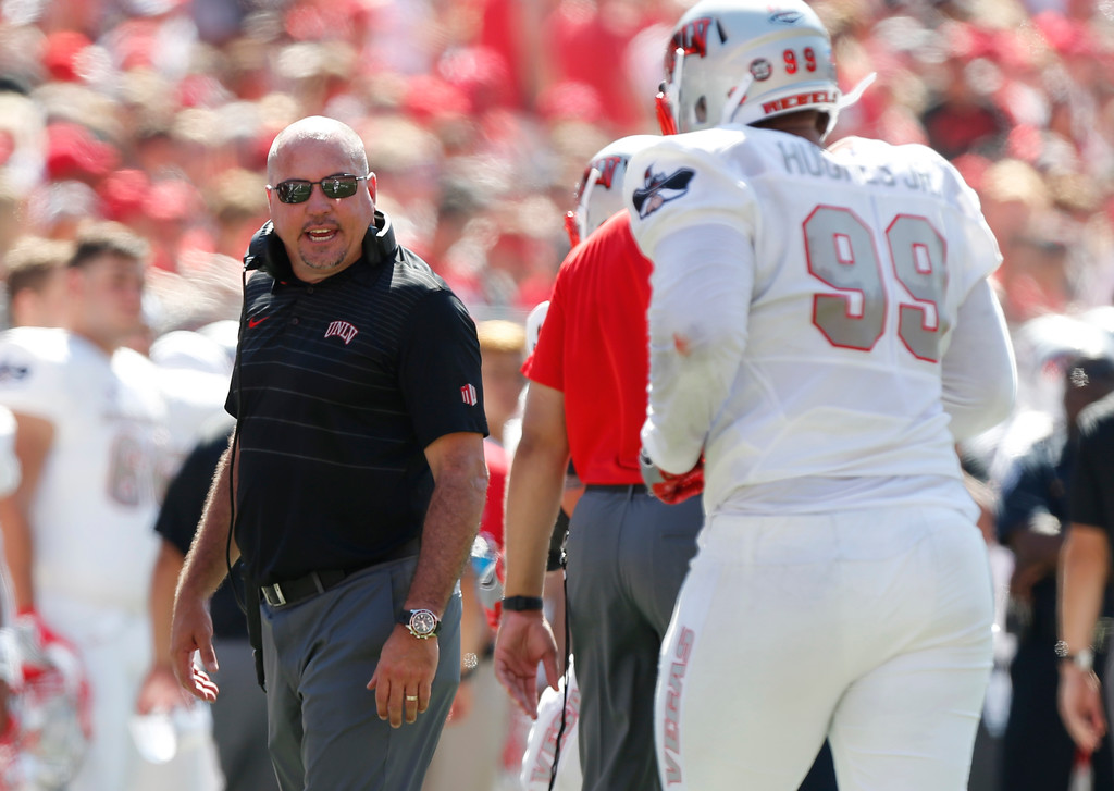 . UNLV head coach Tony Sanchez instructs his team against Ohio State during the first half of an NCAA college football game Saturday, Sept. 23, 2017, in Columbus, Ohio. (AP Photo/Jay LaPrete)