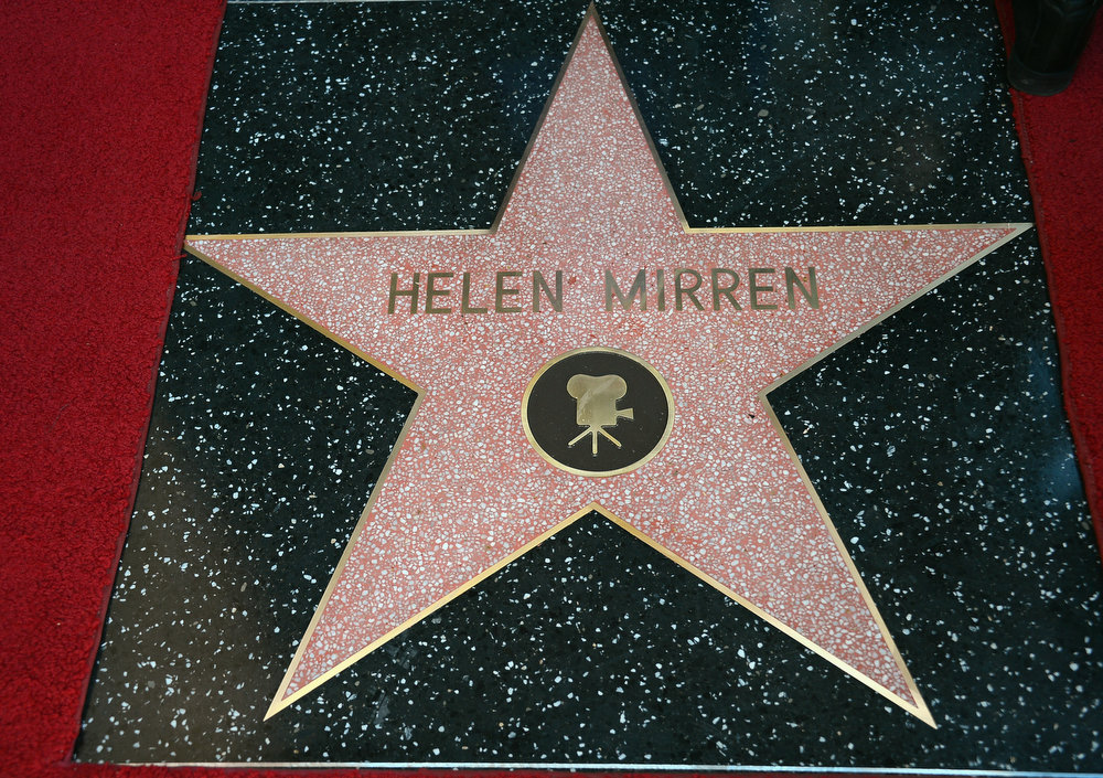 Description of . Helen Mirren Honored On The Hollywood Walk Of Fame on January 3, 2013 in Hollywood, California.  (Photo by Frazer Harrison/Getty Images)